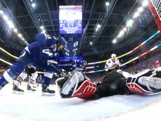 TAMPA, FL - JUNE 03:  Corey Crawford #50 of the Chicago Blackhawks dives for the puck against Brian Boyle #11 of the Tampa Bay Lightning during Game One of the 2015 NHL Stanley Cup Final at Amalie Arena on June 3, 2015 in Tampa, Florida.  (Photo by Bruce Bennett/Getty Images)