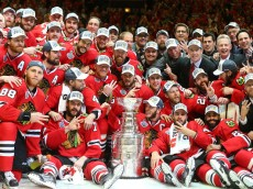 CHICAGO, IL - JUNE 15:  The Chicago Blackhawks pose with the Stanley Cup after defeating the Tampa Bay Lightning  by a score of 2-0 in Game Six to win the 2015 NHL Stanley Cup Final at the United Center  on June 15, 2015 in Chicago, Illinois.  (Photo by Bruce Bennett/Getty Images)