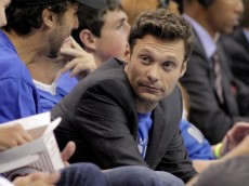 OKLAHOMA CITY, OK - JUNE 02:  TV personality Ryan Seacrest looks down the aisle from his courtside seat as the Oklahoma City Thunder take on the San Antonio Spurs in Game Four of the Western Conference Finals of the 2012 NBA Playoffs at Chesapeake Energy Arena on June 2, 2012 in Oklahoma City, Oklahoma. NOTE TO USER: User expressly acknowledges and agrees that, by downloading and or using this photograph, User is consenting to the terms and conditions of the Getty Images License Agreement.  (Photo by Brett Deering/Getty Images)