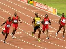 BEIJING, CHINA - AUGUST 23:  Usain Bolt of Jamaica (R) wins gold ahead of (L-R) Justin Gatlin of the United States, Tyson Gay of the United States, Mike Rodgers of the United States and Trayvon Bromell of the United States during the Men's 100 metres final during day two of the 15th IAAF World Athletics Championships Beijing 2015 at Beijing National Stadium on August 23, 2015 in Beijing, China.  (Photo by Maxx Wolfson/Getty Images)