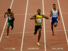 BEIJING, CHINA - AUGUST 27:  Usain Bolt of Jamaica crosses the finish line to win gold ahead of Anaso Jobodwana of South Africa (L) in the Men's 200 metres final during day six of the 15th IAAF World Athletics Championships Beijing 2015 at Beijing National Stadium on August 27, 2015 in Beijing, China.  (Photo by Lintao Zhang/Getty Images for IAAF)