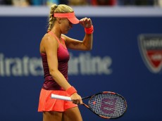 NEW YORK, NY - SEPTEMBER 06:  Kristina Mladenovic of France shows her dejection against Ekaterina Makarova of Russia in their womens singles fourth round match on Day Seven of the 2015 US Open at the USTA Billie Jean King National Tennis Center on September 6, 2015 in the Flushing neighborhood of the Queens borough of New York City.  (Photo by Clive Brunskill/Getty Images)
