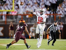 BLACKSBURG, VA - SEPTEMBER 7: Cardale Jones #12 of the Ohio State Buckeyes throws an interception while under pressure from Andrew Motuapuaka #54 of the Virginia Tech Hokies in the second quarter at Lane Stadium on September 7, 2015 in Blacksburg, Virginia. (Photo by Joe Robbins/Getty Images)