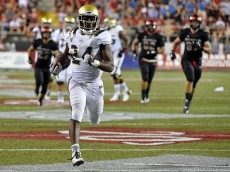 LAS VEGAS, NV - SEPTEMBER 12:  Paul Perkins #24 of the UCLA Bruins runs in for a touchdown against the UNLV Rebels during his game at Sam Boyd Stadium on September 12, 2015 in Las Vegas, Nevada. UCLA won 37-3.  (Photo by David Becker/Getty Images)