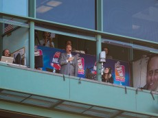 BOSTON, MA - SEPTEMBER 27: Don Orsillo acknowledges the crowd from the booth during his last game as the play-by-play announcer for Boston Red Sox games on the New England Sports Network, waves to the crowd after a video tribute during the seventh inning at Fenway Park on September 27, 2015 in Boston, Massachusetts. (Photo by Rich Gagnon/Getty Images)