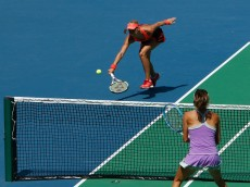 WUHAN, CHINA - OCTOBER 01:  Andrea Hlavackova of Czech Republic returns a shot during her match against against Gabriela Dabrowski of Canada and Alicja Rosolska of Poland at 2015 Dongfeng Motor Wuhan Open at Optics Valley International Tennis Centre on October 1, 2015 in Wuhan, China.  (Photo by Kevin Lee/Getty Images)