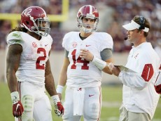 COLLEGE STATION, TX - OCTOBER 17:  Offensive coordinator Lane Kiffin of the Alabama Crimson Tide chats with his quarterback Jake Coker #14  and Derrick Henry #2 on the sideline during the second half of their game against the Texas A&M Aggies at Kyle Field on October 17, 2015 in College Station, Texas.  (Photo by Scott Halleran/Getty Images)