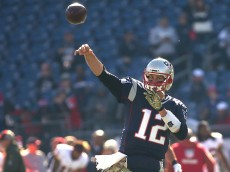 FOXBORO, MA - NOVEMBER 8: Tom Brady #12 of the New England Patriots throws before a game with the Washington Redskins at Gillette Stadium on November 8, 2015 in Foxboro, Massachusetts. (Photo by Jim Rogash/Getty Images)