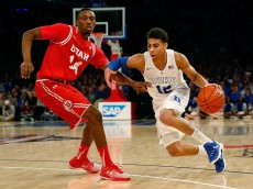 NEW YORK, NY - DECEMBER 19:  Dakarai Tucker #14 of the Utah Utes defends against Derryck Thornton #12 of the Duke Blue Devils during the Ameritas Insurance Classic at Madison Square Garden on December 19, 2015 in New York City.  (Photo by Mike Stobe/Getty Images)