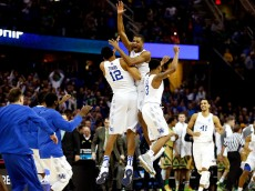 CLEVELAND, OH - MARCH 28: Aaron Harrison #2 of the Kentucky Wildcats celebrates with teammates after defeating the Notre Dame Fighting Irish during the Midwest Regional Final of the 2015 NCAA Men's Basketball tournament at Quicken Loans Arena on March 28, 2015 in Cleveland, Ohio.  (Photo by Gregory Shamus/Getty Images)