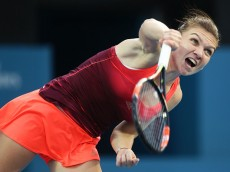 SYDNEY, AUSTRALIA - JANUARY 12:  Simona Halep of Romania serves in her match against Caroline Garcia of France during day three of the 2016 Sydney International at Sydney Olympic Park Tennis Centre on January 12, 2016 in Sydney, Australia.  (Photo by Matt King/Getty Images)