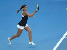 SYDNEY, AUSTRALIA - JANUARY 13:  Monica Puig of Puerto Rico plays a forehand in her match against Sam Stosur of Australia during day four of the Sydney International at Sydney Olympic Park Tennis Centre on January 13, 2016 in Sydney, Australia.  (Photo by Mark Metcalfe/Getty Images)