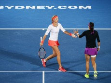 SYDNEY, AUSTRALIA - JANUARY 15:  Kristina Mladenovic (L) and Caroline Garcia (R) of France play in the womens doubles final against Sania Mirza of India and Martina Hingis of Switzerland during day six of the 2016 Sydney International at Sydney Olympic Park Tennis Centre on January 15, 2016 in Sydney, Australia.  (Photo by Matt King/Getty Images)