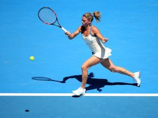MELBOURNE, AUSTRALIA - JANUARY 18:  Camila Giorgi of Italy plays a forehand in her first round match against Serena Williams of the United States during day one of the 2016 Australian Open at Melbourne Park on January 18, 2016 in Melbourne, Australia.  (Photo by Quinn Rooney/Getty Images)