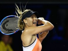 MELBOURNE, AUSTRALIA - JANUARY 20:  Maria Sharapova of Russia plays a forehand in her second round match against Aliaksandra Sasnovich of Belarus during day three of the 2016 Australian Open at Melbourne Park on January 20, 2016 in Melbourne, Australia.  (Photo by Scott Barbour/Getty Images)