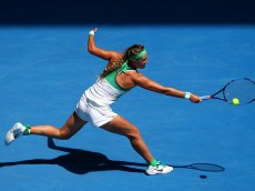 MELBOURNE, AUSTRALIA - JANUARY 25:  Victoria Azarenka of Belarus plays a backhand in her fourth round match against Barbora Strycova of the Czech Republic during day eight of the 2016 Australian Open at Melbourne Park on January 25, 2016 in Melbourne, Australia.  (Photo by Mark Kolbe/Getty Images)