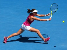 XXX of ZZZ plays a forehand in his/her quarter final match against XXXX of ZZZZ during day 10 of the 2016 Australian Open at Melbourne Park on January 27, 2016 in Melbourne, Australia.