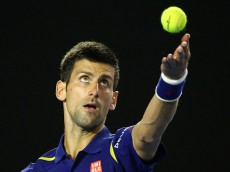 MELBOURNE, AUSTRALIA - JANUARY 28:  Novak Djokovic of Serbia serves in his semi final match against Roger Federer of Switzerland during day 11 of the 2016 Australian Open at Melbourne Park on January 28, 2016 in Melbourne, Australia.  (Photo by Scott Barbour/Getty Images)
