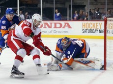NEW YORK, NY - JANUARY 25: Jaroslav Halak #41 of the New York Islanders makes the first period save on Tomas Jurco #26 of the Detroit Red Wings at the Barclays Center on January 25, 2016 in the Brooklyn borough of New York City. The Red Wings defeated the Islanders 4-2. (Photo by Bruce Bennett/Getty Images)