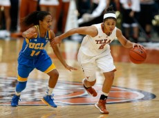 HOUSTON, TX - DECEMBER 08:  Celina Rodrigo #2 of the Texas Longhorns drives past Mariah Williams #14 of the UCLA Bruins during the MD Anderson Proton Therapy Showcase at Reliant Stadium on December 8, 2012 in Houston, Texas.  (Photo by Scott Halleran/Getty Images)