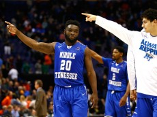 ST LOUIS, MO - MARCH 18: Giddy Potts #20 of the Middle Tennessee Blue Raiders and teammates acknowledge the fans after defeating the Michigan State Spartans during the first round of the 2016 NCAA Men's Basketball Tournament at Scottrade Center on March 18, 2016 in St Louis, Missouri.  (Photo by Jamie Squire/Getty Images)