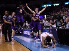 OKLAHOMA CITY, OK - MARCH 18: Isaiah Taylor #1 of the Texas Longhorns reacts after Paul Jesperson #4 of the Northern Iowa Panthers hit a half court three pointer to win the game with a score of 75 to 72 during the first round of the 2016 NCAA Men's Basketball Tournament at Chesapeake Energy Arena on March 18, 2016 in Oklahoma City, Oklahoma.  (Photo by Ronald Martinez/Getty Images)