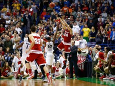 ST LOUIS, MO - MARCH 20:  Bronsosn Koenig #24 of the Wisconsin Badgers shoots and makes the game winning basket against Remy Abell #10 of the Xavier Musketeers during the second round of the 2016 NCAA Men's Basketball Tournament at Scottrade Center on March 20, 2016 in St Louis, Missouri.  (Photo by Jamie Squire/Getty Images)