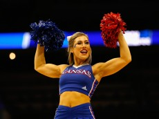 LOUISVILLE, KY - MARCH 24:  A Kansas Jayhawks cheerleader performs during the game between the Kansas Jayhawks and the Maryland Terrapins in the third round of the 2016 NCAA Men's Basketball Tournament at KFC YUM! Center on March 24, 2016 in Louisville, Kentucky.  (Photo by Kevin C. Cox/Getty Images)