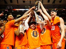 CHICAGO, IL - MARCH 27:  The Syracuse Orange celebrate their 68 to 62 win over the Virginia Cavaliers with teammates during the 2016 NCAA Men's Basketball Tournament Midwest Regional Final at United Center on March 27, 2016 in Chicago, Illinois.  (Photo by Jamie Squire/Getty Images)