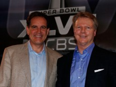 NEW ORLEANS, LA - JANUARY 29:  CBS Sports announcers Jim Nantz (L) and Phil Simms pose on stage at a CBS Super Bowl XLVII Broadcasters Press Conference at the New Orleans Convention Center on January 29, 2013 in New Orleans, Louisiana.  (Photo by Scott Halleran/Getty Images)
