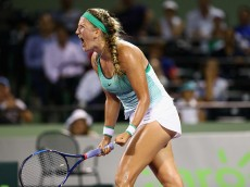 KEY BISCAYNE, FL - MARCH 31:  Victoria Azarenka of Belarus celebrates a point against Angelique Kerber of Germany in their semi final match during the Miami Open Presented by Itau at Crandon Park Tennis Center on March 31, 2016 in Key Biscayne, Florida.  (Photo by Clive Brunskill/Getty Images)