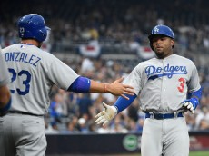 SAN DIEGO, CALIFORNIA - APRIL 06:  Carl Crawford #3 of the Los Angeles Dodgers, right, is congratulated by Adrian Gonzalez #23 after scoring during the first inning of a baseball game against the San Diego Padres at PETCO Park on April 6, 2016 in San Diego, California.  (Photo by Denis Poroy/Getty Images)