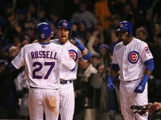 CHICAGO, IL - APRIL 11: Addison Russell #27 of the Chicago Cubs is greeted by Ben Zobrist #18 and Jorge Soler #68 after hitting the game-winning, three run home run in the 8th inning against the Cincinnati Reds during the home opener at Wrigley Field on April 11, 2016 in Chicago, Illinois.  (Photo by Jonathan Daniel/Getty Images)