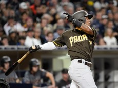SAN DIEGO, CALIFORNIA - APRIL 15: Alexi Amarista of the San Diego Padres hits an RBI single during the fourth inning of a baseball game against the Arizona Diamondbacks at PETCO Park on April 15, 2016 in San Diego, California. All players are wearing #42 in honor of Jackie Robinson Day. (Photo by Denis Poroy/Getty Images)