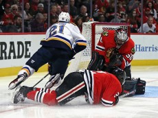CHICAGO, IL - APRIL 17: Corey Crawford #50 of the Chicago Blackhawks makes a save against Patrik Berglund #21 of the St. Louis Blues as Duncan Keith #2 sprawls on the ice to defend in Game Three of the Western Conference Quarterfinals during the 2016 NHL Stanley Cup Playoffs at the United Center on April 5, 2016 in Chicago, Illinois. The Blues defeated the Blackhawks 3-2. (Photo by Jonathan Daniel/Getty Images)
