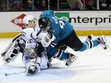 SAN JOSE, CA - APRIL 20:  Matt Nieto #83 of the San Jose Sharks collides with Brayden McNabb #3 and Jonathan Quick #32 of the Los Angeles Kings in the second period in Game Four of the Western Conference First Round during the NHL 2016 Stanley Cup Playoffs at SAP Center on April 20, 2016 in San Jose, California.  (Photo by Ezra Shaw/Getty Images)