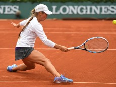 PARIS, FRANCE - JUNE 02:  Yulia Putintseva of Kazakhstan hits a forehand during the Ladies Singles quarter final match against Serena Williams of the United States on day twelve of the 2016 French Open at Roland Garros on June 2, 2016 in Paris, France.  (Photo by Dennis Grombkowski/Getty Images)