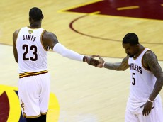CLEVELAND, OH - JUNE 16:  LeBron James #23 and J.R. Smith #5 of the Cleveland Cavaliers celebrate late in the game against the Golden State Warriors in Game 6 of the 2016 NBA Finals at Quicken Loans Arena on June 16, 2016 in Cleveland, Ohio. NOTE TO USER: User expressly acknowledges and agrees that, by downloading and or using this photograph, User is consenting to the terms and conditions of the Getty Images License Agreement.  (Photo by Ezra Shaw/Getty Images)