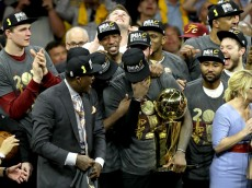 OAKLAND, CA - JUNE 19:  LeBron James #23 of the Cleveland Cavaliers celebrates with the Larry O'Brien Championship Trophy after defeating the Golden State Warriors 93-89 in Game 7 of the 2016 NBA Finals at ORACLE Arena on June 19, 2016 in Oakland, California. NOTE TO USER: User expressly acknowledges and agrees that, by downloading and or using this photograph, User is consenting to the terms and conditions of the Getty Images License Agreement.  (Photo by Ronald Martinez/Getty Images)
