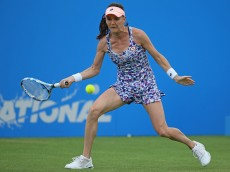 EASTBOURNE, ENGLAND - JUNE 23: Agnieszka Radwanska of Poland plays a forehand during her women's quarter final singles match against Dominica Cibulkova of Slovakia on day five of the WTA Aegon International at Devonshire Park on June 23, 2016 in Eastbourne, England. (Photo by Steve Bardens/Getty Images for LTA)