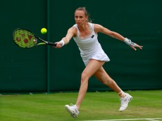 LONDON, ENGLAND - JUNE 28:  Magdalena Rybarikova of Slovakia plays a forehand during the Ladies Singles first round match against Eugenie Bouchard of Canada on day two of the Wimbledon Lawn Tennis Championships at the All England Lawn Tennis and Croquet Club on June 28, 2016 in London, England.  (Photo by Adam Pretty/Getty Images)