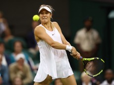 LONDON, ENGLAND - JUNE 29:  Eugenie Bouchard of Canada plays a backhand during the Ladies Singles first round match against Magdalena Rybarikova of Slovakia on day three of the Wimbledon Lawn Tennis Championships at the All England Lawn Tennis and Croquet Club on June 29, 2016 in London, England.  (Photo by Julian Finney/Getty Images)
