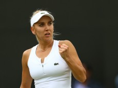 LONDON, ENGLAND - JULY 04:  Elena Vesnina of Russia reacts during the Ladies Singles fourth round match against Ekaterina Makarova of Russia on day seven of the Wimbledon Lawn Tennis Championships at the All England Lawn Tennis and Croquet Club on July 4, 2016 in London, England.  (Photo by Julian Finney/Getty Images)