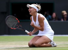 LONDON, ENGLAND - JULY 05:  Elena Vesnina of Russia celebrates victory during the Ladies Singles Quarter Finals match against Dominika Cibulkova of Slovakia on day eight of the  Wimbledon Lawn Tennis Championships at the All England Lawn Tennis and Croquet Club on July 5, 2016 in London, England.  (Photo by Julian Finney/Getty Images)