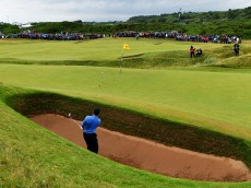 TROON, SCOTLAND - JULY 15:  Rory McIlroy of Northern Ireland hits a bunker shot on the 8th during the second round on day two of the 145th Open Championship at Royal Troon on July 15, 2016 in Troon, Scotland.  (Photo by Stuart Franklin/Getty Images)
