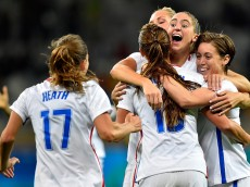 BELO HORIZONTE, BRAZIL - AUGUST 03: Morgan Brian #14 of United States, Tobin Heath #17 of United States, Meghan Klingenberg #7 of United States and Alex Morgan #13 of United States  celebrate after Alex Morgan scores in the Women's Group G first round match between the United States and New Zealand during the Rio 2016 Olympic Games at Mineirao Stadium on August 3, 2016 in Belo Horizonte, Brazil.  (Photo by Pedro Vilela/Getty Images)