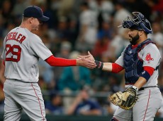 SEATTLE, WA - AUGUST 04:  Relief pitcher Brad Ziegler #29 of the Boston Red Sox is congratulated by catcher Sandy Leon #3 after beating the Seattle Mariners 3-2 in eleven innings at Safeco Field on August 4, 2016 in Seattle, Washington.  (Photo by Otto Greule Jr/Getty Images)