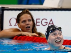 RIO DE JANEIRO, BRAZIL - AUGUST 08:  Lilly King of the United States celebrates winning gold in the Women's 100m Breaststroke Final on Day 3 of the Rio 2016 Olympic Games at the Olympic Aquatics Stadium on August 8, 2016 in Rio de Janeiro, Brazil.  (Photo by Clive Rose/Getty Images)