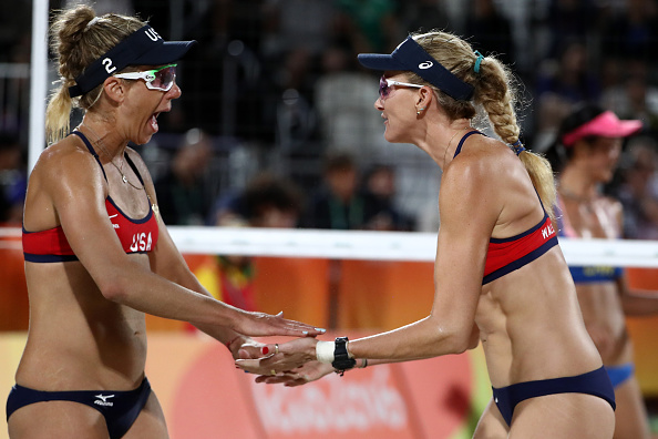 RIO DE JANEIRO, BRAZIL - AUGUST 08: Kerri Walsh Jennings and April Ross of United States celebrate during the Women's Beach Volleyball preliminary round Pool C match against Fan Wang and Yuan Yue of China on Day 3 of the Rio 2016 Olympic Games at the Beach Volleyball Arena on August 8, 2016 in Rio de Janeiro, Brazil. (Photo by Ezra Shaw/Getty Images)