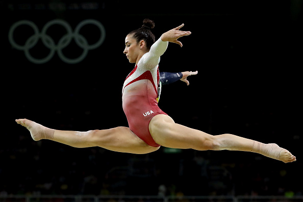RIO DE JANEIRO, BRAZIL - AUGUST 09: Alexandra Raisman of the United States competes on the balance beam during the Artistic Gymnastics Women's Team Final on Day 4 of the Rio 2016 Olympic Games at the Rio Olympic Arena on August 9, 2016 in Rio de Janeiro, Brazil. (Photo by Lars Baron/Getty Images)